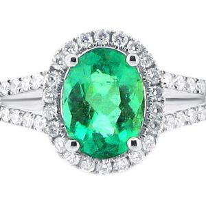 Oval Halo with Scallop Set Split Shank and Green Emerald Centre Stone
